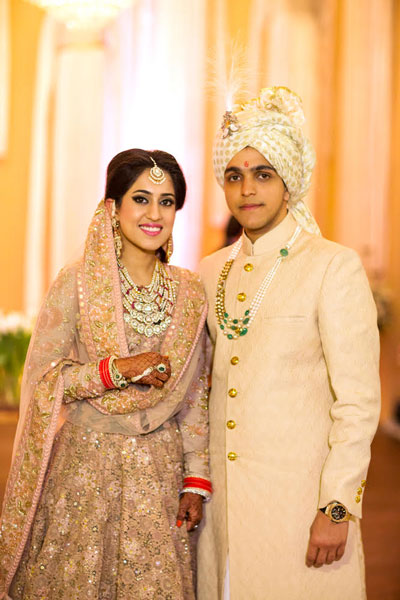 Ridhi Mehra wedding | Ridhi and akshay's Valentine's Day wedding | bride in pale pink Sabyasachi lehenga with Kundan jewellery and groom in creme Rohit Gandhi sherwani