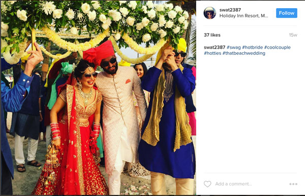 Amazing Indian wedding hashtag ideas from real weddings   How to make a wedding hashtag for a destination wedding  Indian couple under a floral chadar   Bride wearing sunglasses   Aditi and Dhruv wedding