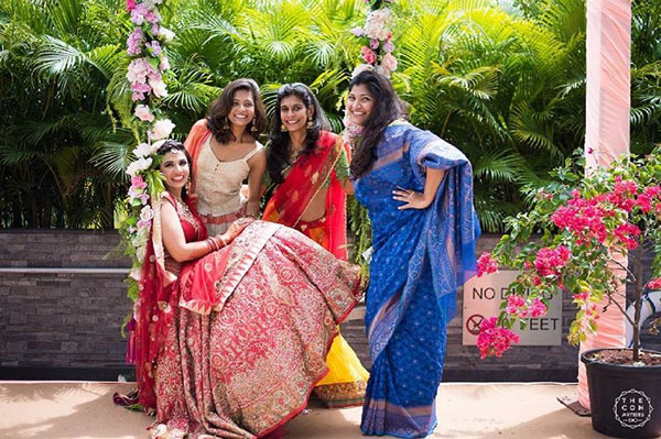 Indian bridesmaids duties | Bride's friends | BFF photos from Indian wedding | Indian bride and her friends on a swing with flowers | The con artists