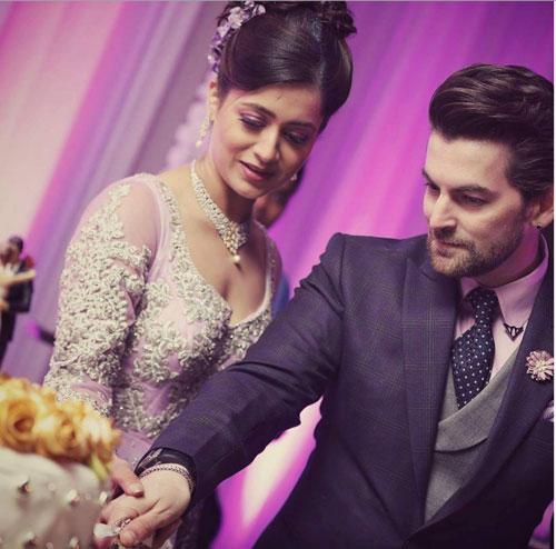 neil anad rukmini cutting the wedding cake