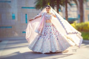 bridal twirl photos | miss style fiesta wedding | Masoom's wedding | bride in beautiful white lehengas with multicoloured floral embroidery | must have wedding pics for the wedding album