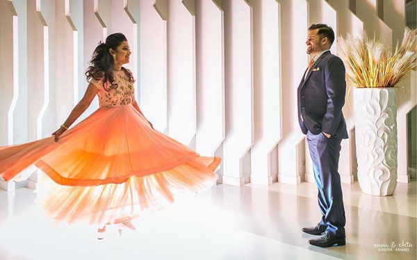 wedding album photos | must have wedding pics for your wedding album | the bridal twirl photos | Indian bride in a luminous orange lehengas