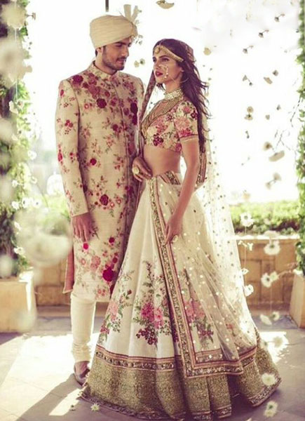 Coordinated outfits, Tips for Couple outfits | Bride and groom wearing matching outfit blouse embroidery matching his sherwani | vogue wedding show