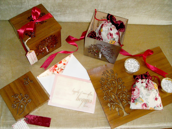 Indian wedding invitation ideas | Wood plus velvet wedding card box with kahwa tea and a pretty floral invite