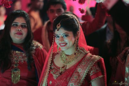 plush affairs photography | Jabalpur wedding | high school sweethearts | Divya and Nikhil | groom in a beige and cream sherwani with gold motifs and bride in a red and gold lehengas | Indian bride and groom | Happy Indian bride