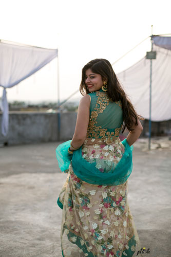 Indian bride in a floral lehenga for her mehendi | Mehndi happy bride | green and ivory floral lehenga | Divya and Nikhil | Bride running in her pretty floral lehenga