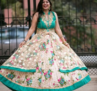 Indian bride in a floral lehenga for her mehendi | Mehndi happy bride | green and ivory floral lehenga | Divya and Nikhil