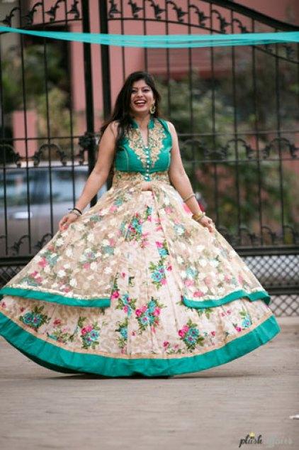 Indian bride in a floral lehenga for her mehendi | Mehndi happy bride | green and ivory floral lehenga | Divya and Nikhil