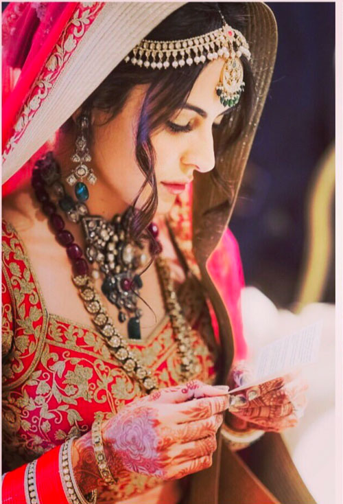 The Mandana Krimi wedding Photos | Mandana looking a pretty Indian Bride in red and gold lehenga blouse with vintage jewellery