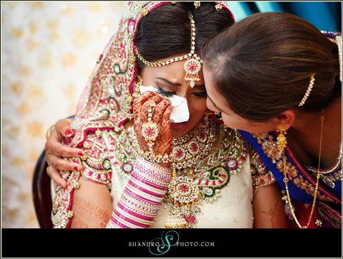 Indian Bride crying on her mother's Shoulder
