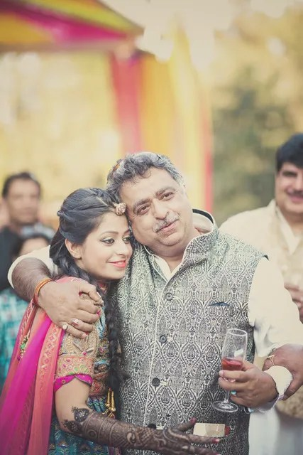 ndian bride posing at her Mehndi Purva and Sahil   wedding in delhi   Father daughter wedding photos   Indian bride with her father at her wedding   emotional father of the bride photos   mUst have father daughter wedding photos