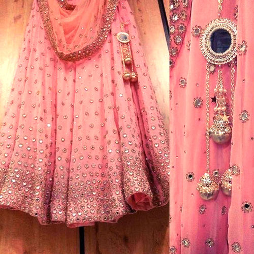 lehenga latkan ideas to spruce up your wedding lehenga | personalised latkans in different shapes | Pink silver an mirror lehenga latkans
