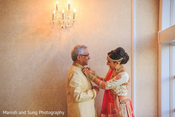 Wedding photos you must have with your dad | Indian bride photos with the feather of the bride | must have wedding photos | Indian bride fixing her fathers bandhgala