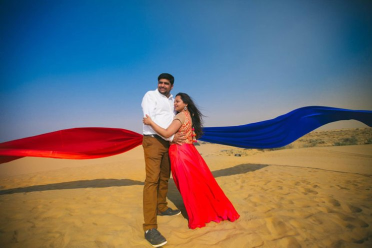 pre wedding shoot in Rajasthan | Bollywood style couple shoot | Veena and Vishal | Shoot (c) Candid Shutters |dreamy Indian wedding shoot in Jaisalmer | photo shoot with flowing drapes