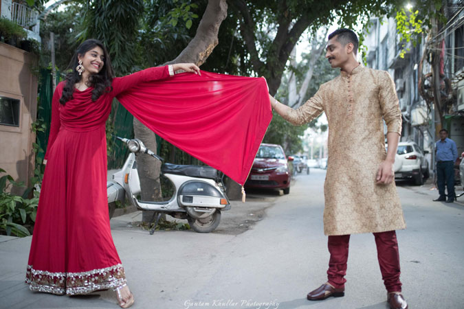 Dhruv and Saina | delhi wedding | cute pre wedding shoot | girl in a simple red suit and groom wearing a sherwani | Pre wedding photoshoot ideas