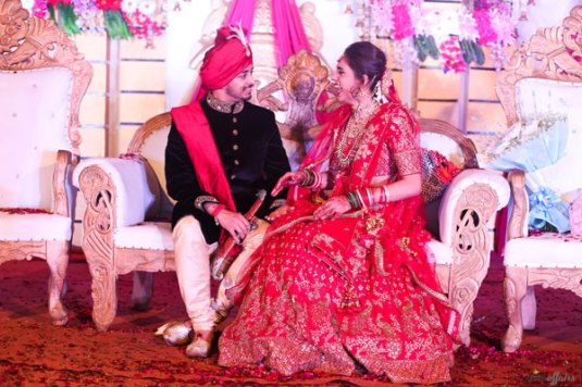 JyotPriya and Nishant | Punjabi wedding in Delhi | The bride and groom involved in some candid conversations.