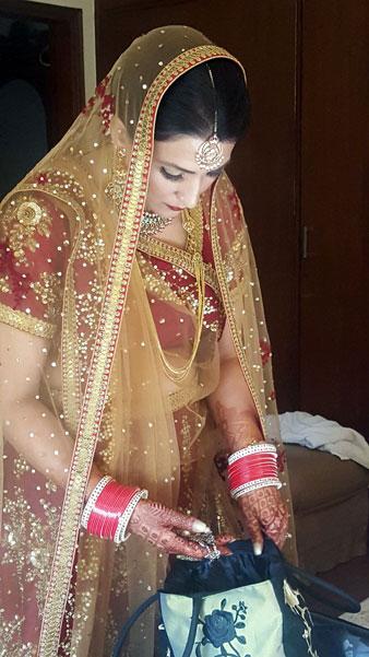 Samiksha and Tony | NRI couple | Lutyens Delhi wedding | The beautiful NRI bride dressed up in her wedding lehenga on her wedding day.
