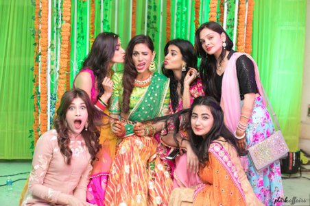 JyotPriya and Nishant | Punjabi wedding in Delhi | The bride posing and having fun at her Sangeet with her girl tribe.