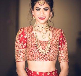 JyotPriya and Nishant | Punjabi wedding in Delhi | The beautiful bride in red lehenga and amazing jewelry.