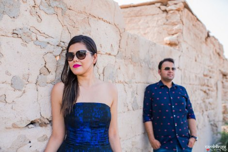 first anniversary idea, anupriya and ankit, aniversary photoshoot | Indian couple photoshoot in the Dubai dessert in matching blue dress and shirt