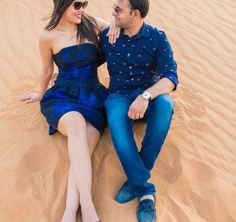first anniversary idea, anupriya and ankit, aniversary photoshoot | Indian couple photoshoot in the Dubai dessert in matching blue dress and shirt