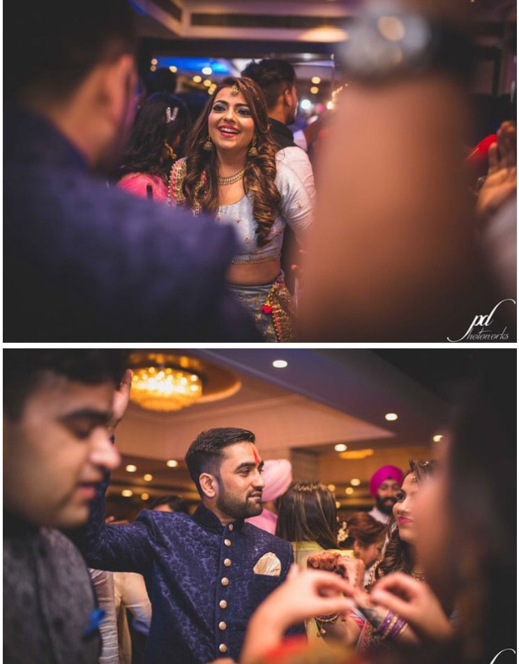 Divya and Balraj | Workplace romance turns in to a cute engagement ceremony | best friend romance | bride in a powder blue ombre lehenag with red and gold embroidery and groom in a blue sherwani with a gold salwarr and pocket square | ring ceremony | bride and groom dancing