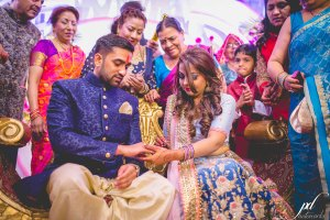 Divya and Balraj | Workplace romance turns in to a cute engagement ceremony | best friend romance | bride in a powder blue ombre lehenag with red and gold embroidery and groom in a blue sherwani with a gold salwarr and pocket square | ring ceremony