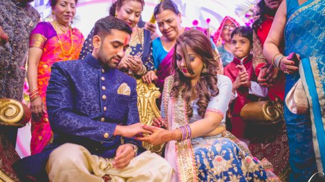 Divya and Balraj   Workplace romance turns in to a cute engagement ceremony   best friend romance   bride in a powder blue ombre lehenag with red and gold embroidery and groom in a blue sherwani with a gold salwarr and pocket square   ring ceremony
