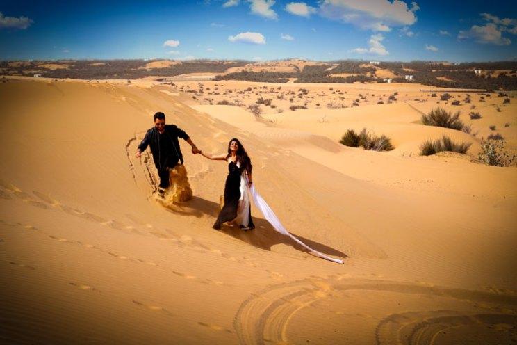 Nindiya and Nirmal | Indian bridal lehenga | Real flower lehenga | The couple's amazing destination pre-wedding shoot amidst the deserts of Dubai.