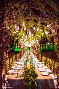 Nindiya and Nirmal | Indian bridal lehenga | Real flower lehenga | The hanging fairylights with the neatly and precisely arranged dining table is just so impeccable.