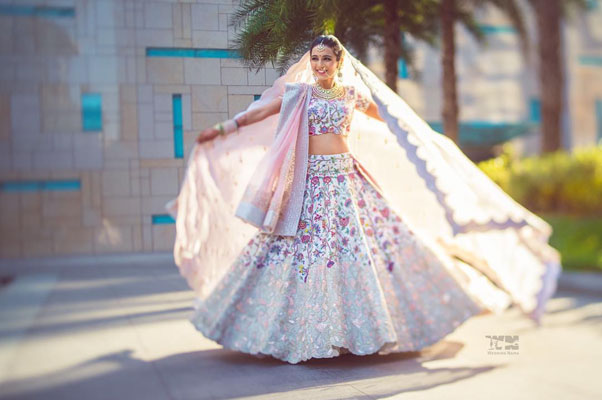 New lehenga styles, Gorgeous lehenga ideas, Unique lehengas | Wedding Nama | Masoon Minawala in a pretty white Anamika Khanna lehenga | white wedding lehenga with colourful Kashmiri embroidery