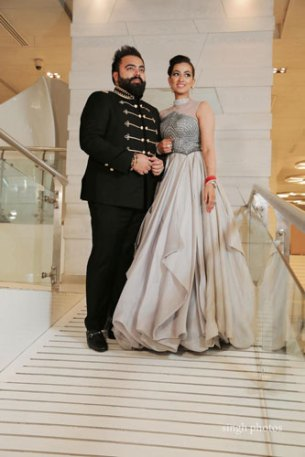 Bavleen and Kushal   Destination wedding in Goa   The groom in his military style jacket and the bride in a sleeveless gown look elegant.