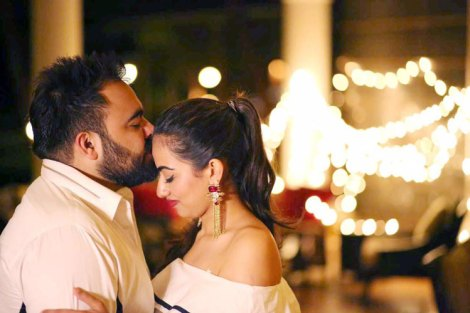 Bavleen and Kushal | Destination wedding in Goa | The groom gives a peck on the forehead to the bride and share a happy moment.