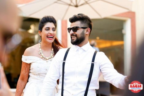 Netika and Kushank | Destination wedding in Jaipur | The bride and groom having a gala time laughing and complimenting each other in chic white outfits.