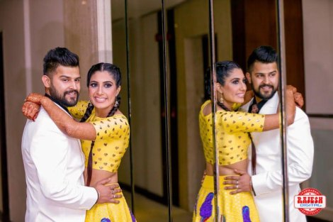 Netika and Kushank | Destination wedding in Jaipur | The bride in her mustard yellow outfit and the groom in his tuxedo sharing a cute, loving moment together.