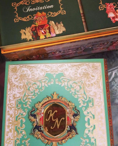 Netika and Kushank | Destination wedding in Jaipur | The beautiful wedding invitation with monograms looked great.