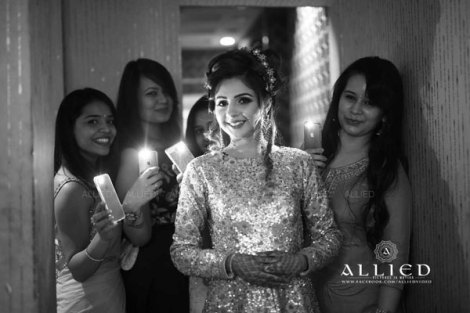 Roka ceremony in delhi, Raveena and Dipanshu | Bride with her friends holding cellphone torch lights
