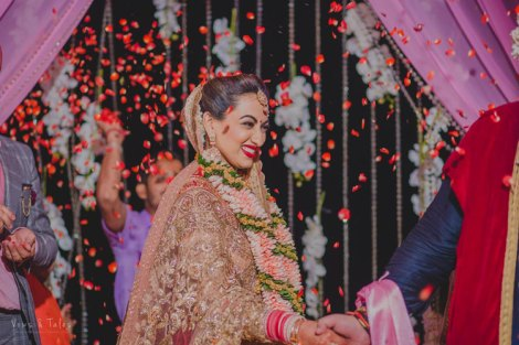 Bavleen and Kushal | Destination wedding in Goa | The beautiful bride smiling while doing the pheras.