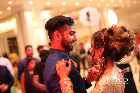 Roka ceremony in delhi, Raveena and Dipanshu | Indian bride to be in a gold sequin gown with her fiancé in a blue suit dancing