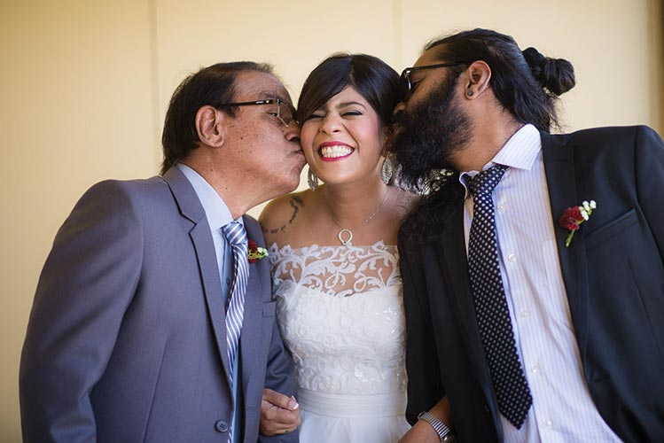 Joshua and Shona   Christian wedding   DIY ideas   The bride being showered with love from her father and brother.