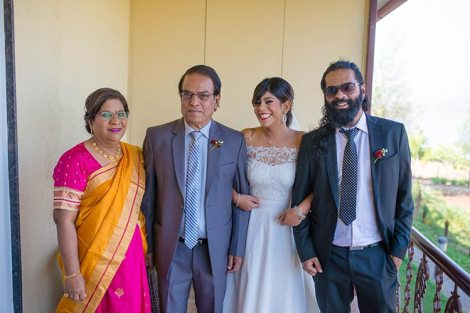 Joshua and Shona | Christian wedding | DIY ideas | The bride posing with her whole family happily.