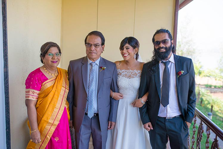 Joshua and Shona   Christian wedding   DIY ideas   The bride posing with her whole family happily.