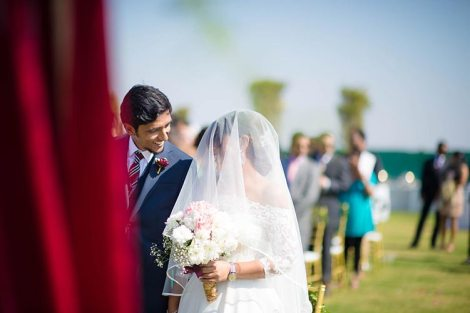 Joshua and Shona   Christian wedding   DIY ideas   The bride and groom looking at each other after the wedding ceremony.