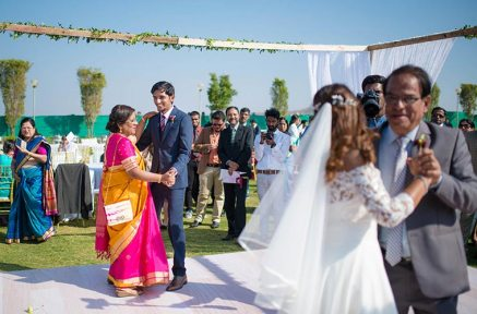 Joshua and Shona   Christian wedding   DIY ideas   The bride and the groom dancing with parents.