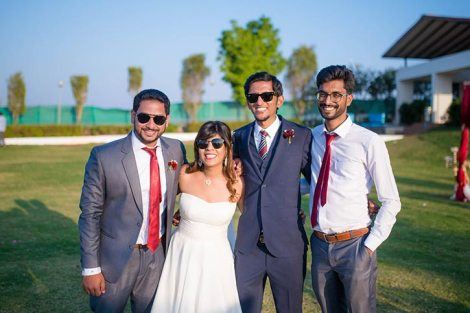Joshua and Shona | Christian wedding | DIY ideas | The bride and groom posing and smiling with their friends.
