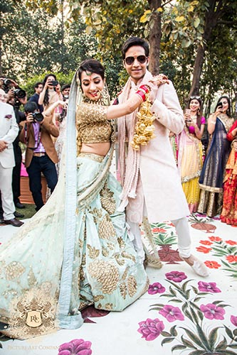 Nayana and Jai | Amazing Delhi wedding | Proposal story | Proposal ideas | The bride and groom dancing together on the floral dance floor.
