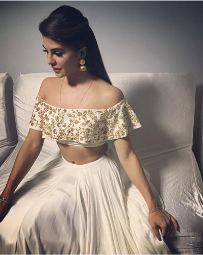 Bridesmaid's Dress ideas bollywood flaunted a.k.a Totally trendingWedding Outfit ideas for the Bride's Best friend | Jaqueline Fernando in a pretty ivory silk lehengas with an off shoulder cape top with golden embroidery perfect for the sangeet
