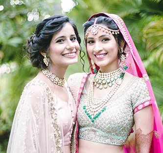 Sagar and Subiya | Destination wedding in Bali | The bride smiling and posing with her friend.