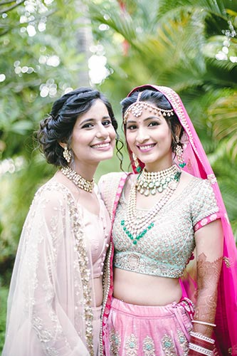 Sagar and Subiya   Destination wedding in Bali   The bride smiling and posing with her friend.