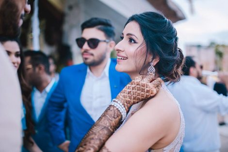 Sagar and Subiya | Destination wedding in Bali | The bride's pretty hairdo and her mehendi inked hands look great.